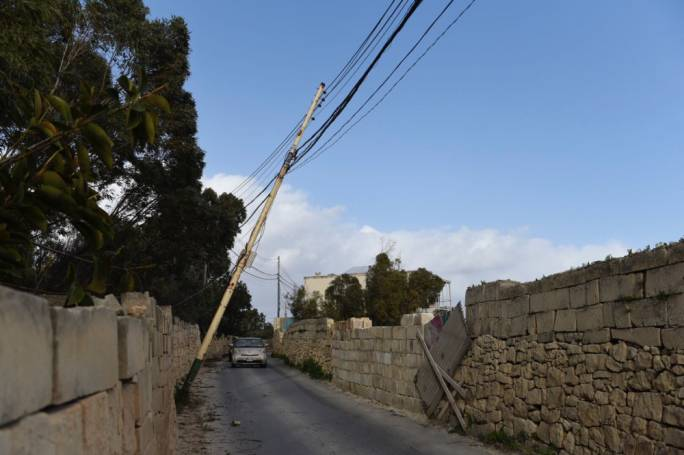 Electricity pole suffers the burden of strong wind