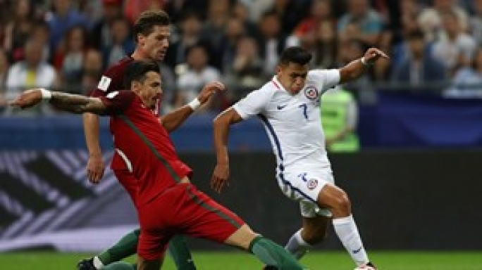 Jose Fonte of Portugal tackles Alexis Sanchez of Chile