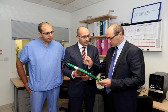 Parliamentary secretary Chris Fearne, at right, visits the medical imaging department at Mater Dei hospital