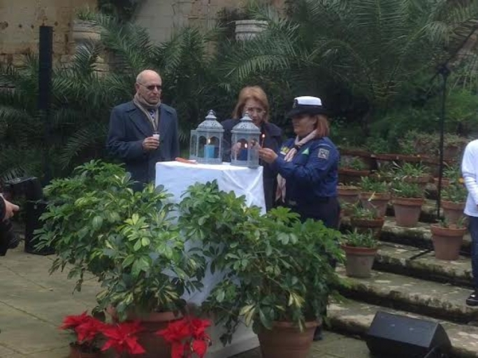 President Coleiro Preca lights a candle from the Peace Flame