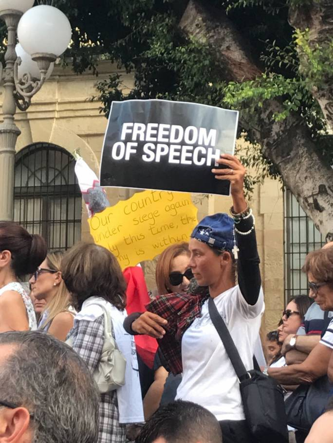 Demonstrator pushing for free speech