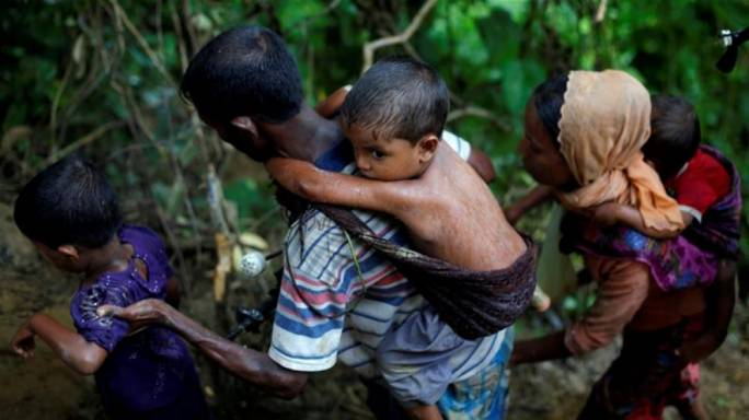 Most of the Rohingya are arriving by foot or boat across Bangladesh's 278km (172 mile) border with Myanmar (Danish Siddiqui /Reuters)