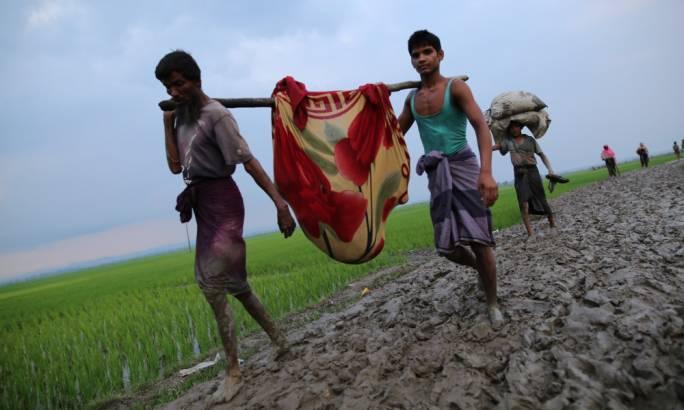 Rohingya Muslims, fleeing military operations in Myanmar's Rakhine state, make their way to Bangladesh. Source: The Guardian