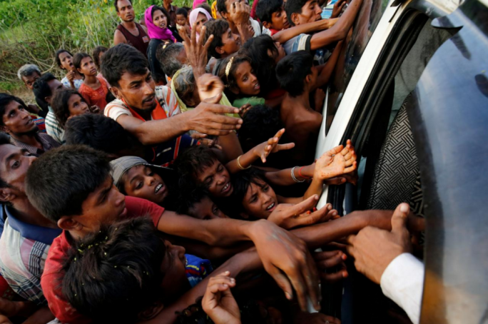 Rohingya refugees stretch their hands for food near Balukhali in Cox's Bazar, Bangladesh. Photo: Reuters
