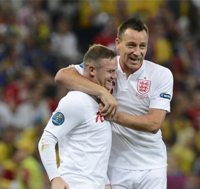 Wayne Rooney celebrates with John Terry.