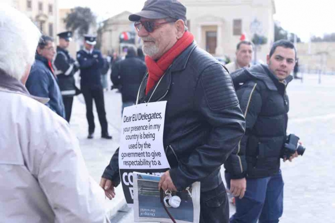 Salvu Mallia holds a one-man protest outside Castille. Photo: James Bianchi