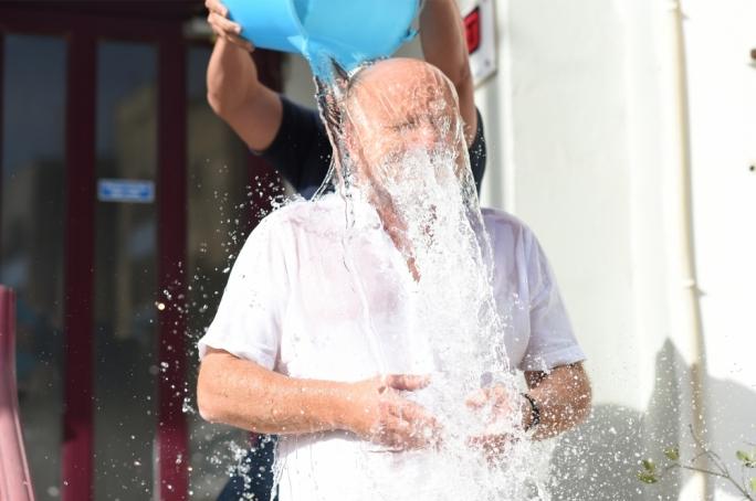 Saviour Balzan braves a nice serving of ice cold water...