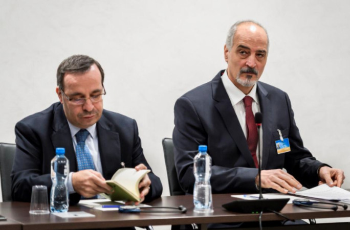 Syrian ambassador to the UN and the head of government delegation Bashar al-Jafaari (right) and a member of his delegation in Geneva, Switzerland on 14 December (Photo: Reuters)