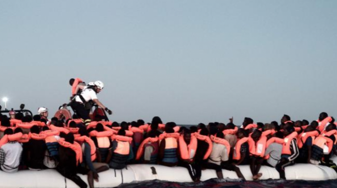 Migrants being rescued before boarding Aquarius