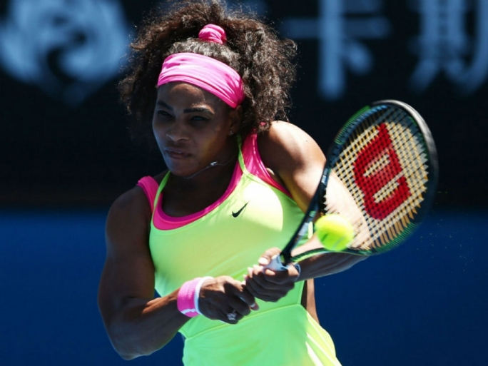 Serena Williams plays a backhand in her third round match against Elina Svitolina