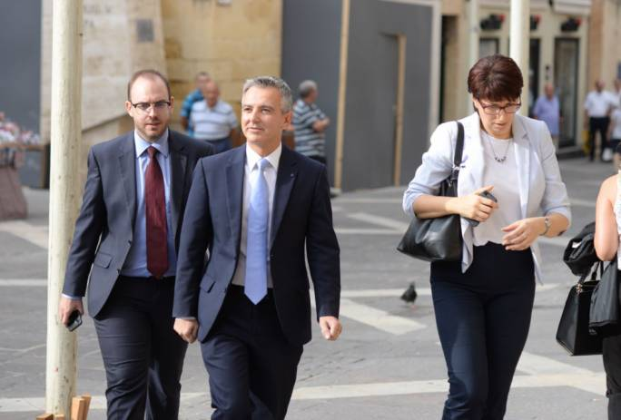 Simon Busuttil, flanked by outgoing secretary-general Rosette Thake, make their way to court this morning (Photo: James Bianchi/MediaToday)