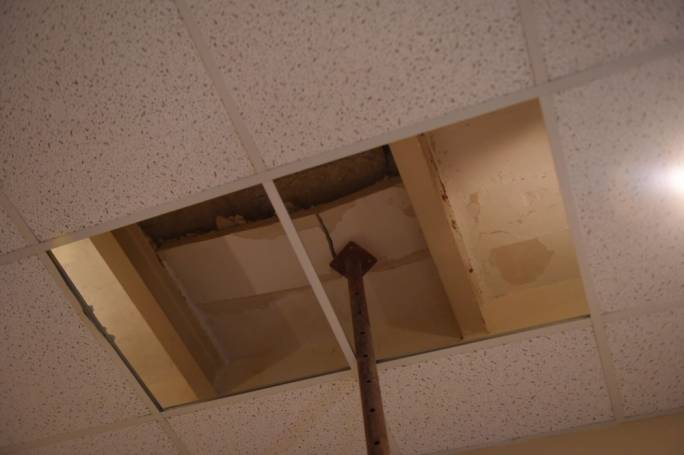 Part of the bedroom ceiling crashed down after bricks were dislodged from an overhead crane (Photo: James Bianchi/MediaToday)