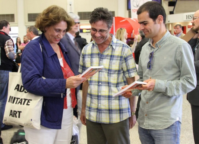 Suad Amiry leafing through the Maltese version of her 'Sharon and my mother-in law' on arrival in Malta