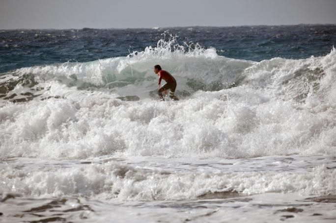 Riding the waves in Ghajn Tuffieha • Photos by Chris Mangion