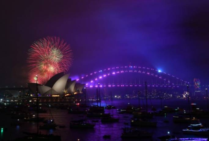 Sydney ushered in the New Year with a spectacular fireworks display and a rainbow waterfall (Photo: Getty)