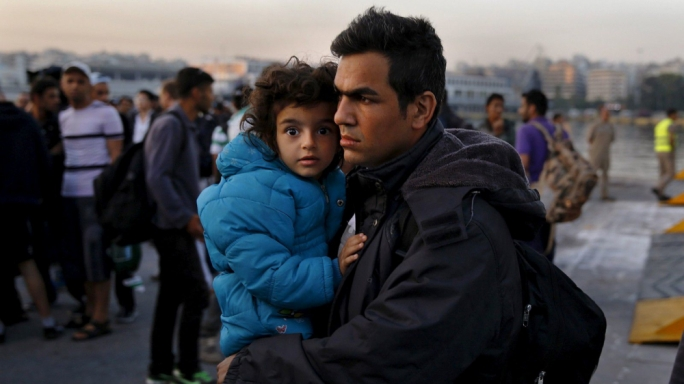 A Syrian father and his daughter during one of the crossings between Turkey and Greece.