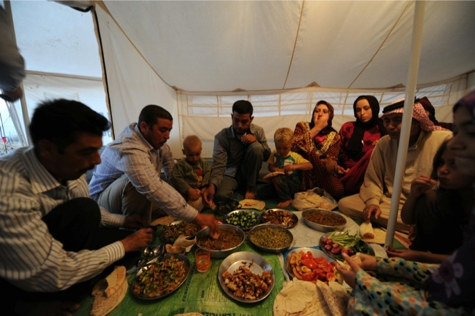 Breaking the day's fast - photo: Karl Schembri/Oxfam