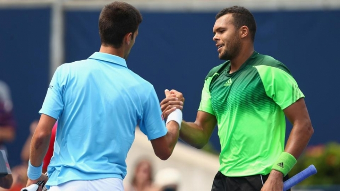 Jo-Wilfried Tsonga of France (R) shakes hands with Novak Djokovic of Serbia after their match at the Toronto Masters