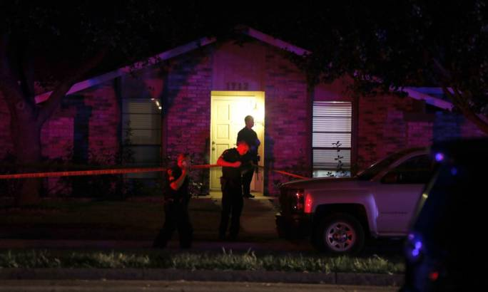 Police officers work the scene of a shooting at a home in Plano, Texas Photo: AP