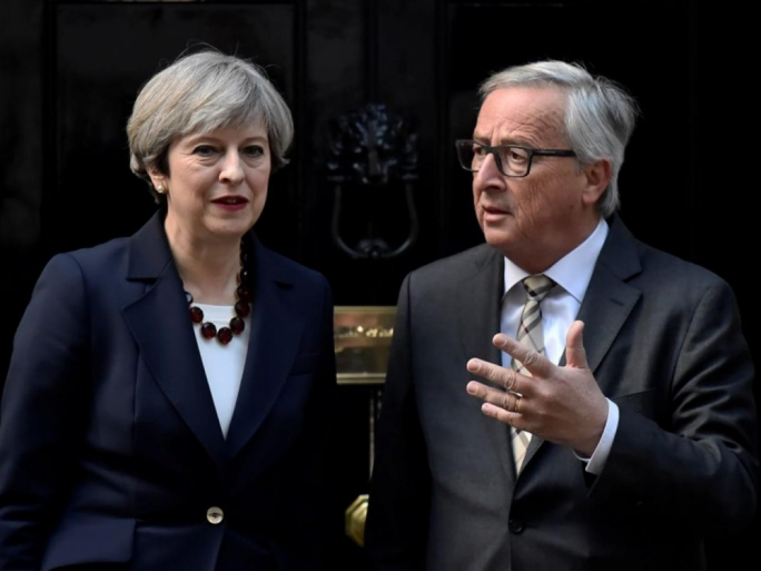 EU commission president Jean Claude Juncker alongside British PM Theresa May