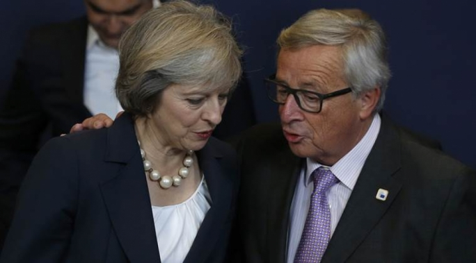 Theresa May has brushed off her spat with Jean-Claude Juncker and said that EU leaders reacted positively to her offer on EU citizens
