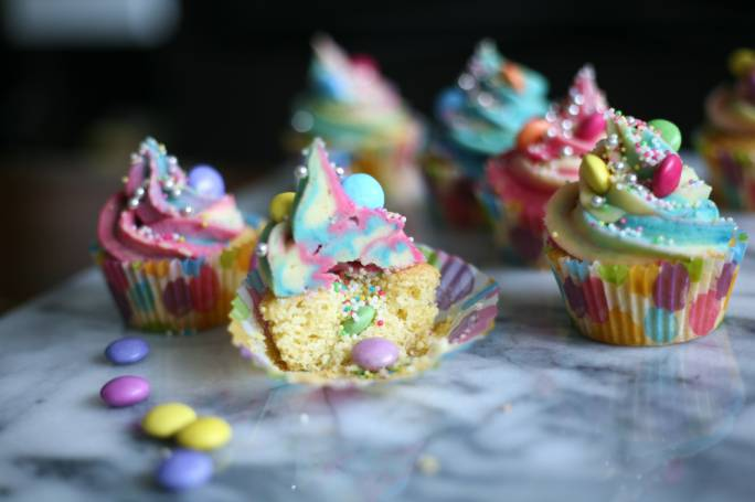 Unicorn cupcakes with an exploding rainbow centre