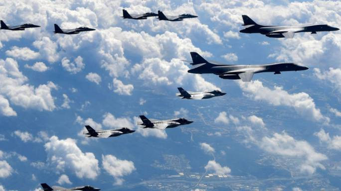 US bombers have flown close to North Korea's east coast to demonstrate the military options available to defeat any threat
