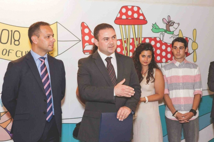 V18 Chairman Jason Micallef (left) and Culture Minister Owen Bonnici at the inauguration of the Valletta Cruise Port embarkation terminal wall, which was given a makeover by MCAST Art and Design students as part of a V18-sponsored initiative.