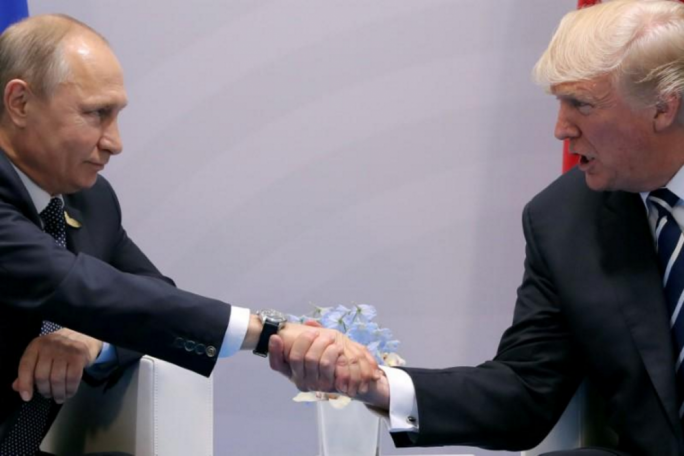 US President Donald Trump shakes hands with Russian President Vladimir Putin during the their bilateral meeting at the G20 summit in Hamburg, Germany, on 7 July