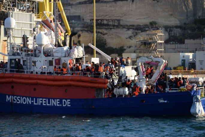 Rescue ship carrying 230 migrants docks in Malta, ending week-long stand-off