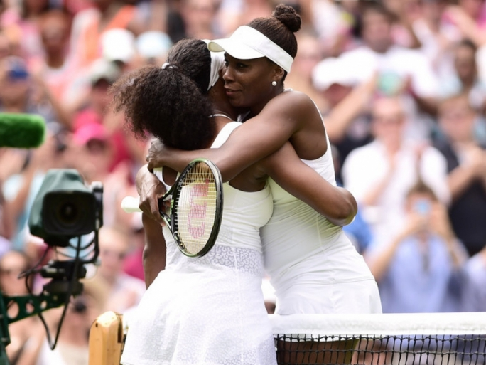 Serena Williams and Venus Williams embrace after their match