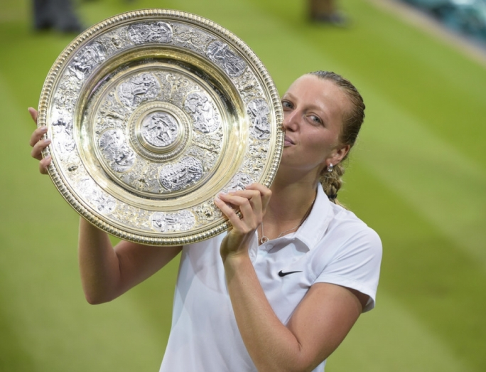 Petra Kvitova of Czech Republic holds the championship trophy following her victory over Eugenie Bouchard of Canada in the women's singles final of the Wimbledon Championships at the All England Lawn Tennis Club, in London, Britain. Photo EPA/FACUNDO ARRIZABALAGA