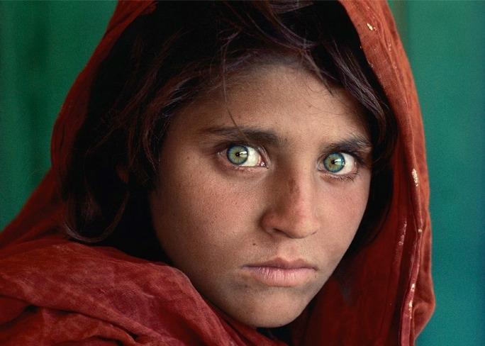 Steve McCurry's 1984 photograph of a Pakistani refugee Sharbat Gula - dubbed 'Afghan Girl' - has been compared to Leonardo da Vinci's Mona Lisa.