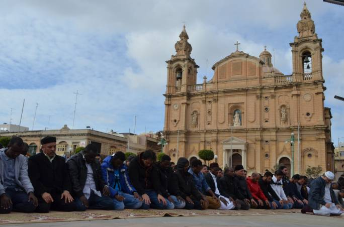 Culture clash or integration? Muslim men pray outside in Msida in a symbolic demonstration over the lack of alternative mosques and prayer rooms
