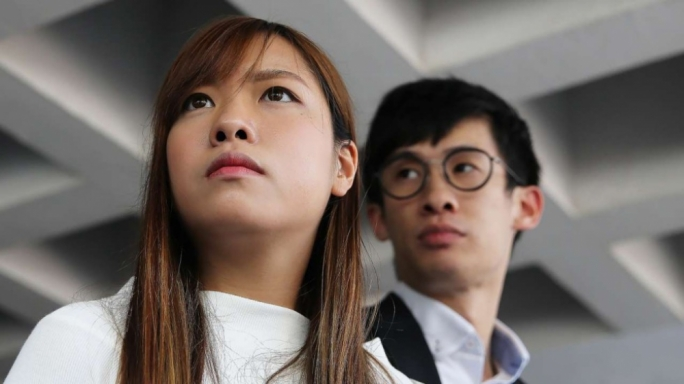 Hong Kong arrests 2 disqualified lawmakers over oath fracas