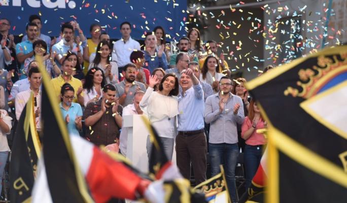 Simon Busuttil and his partner Kristina Chetcuti at a PN mass meeting. Photo: James Bianchi