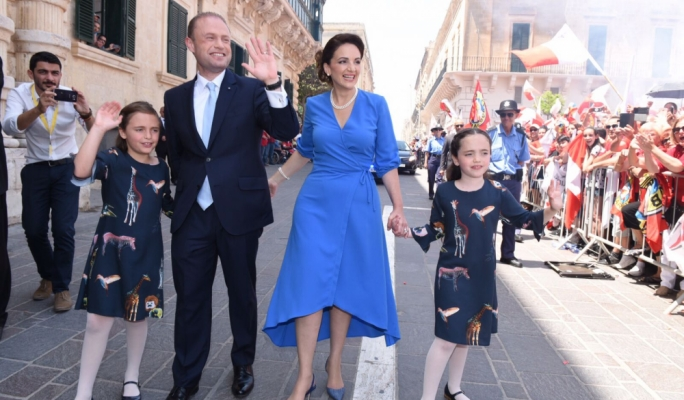 Joseph Muscat, with his wife Michelle and their twin daughters Etoile and Soleil, making their way down Republic Street in Valletta