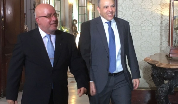 The principal permanent secretary Mario Cutajar (left) arrives at the Palace with Keith Schembri, the OPM chief of staff