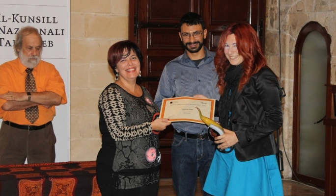 Leanne Ellul receiving the Novels for Youth prize for her novel 'Gramma'