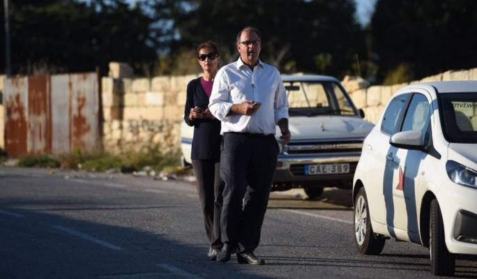 Husband Peter Caruana Galizia outside the family home, where the murder happened. Photo: James Bianchi