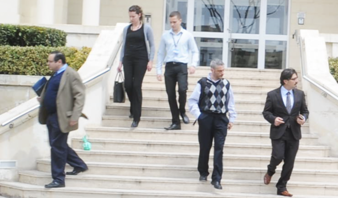 Magistrate Aaron Bugeja (right) emerging from Pilatus Bank