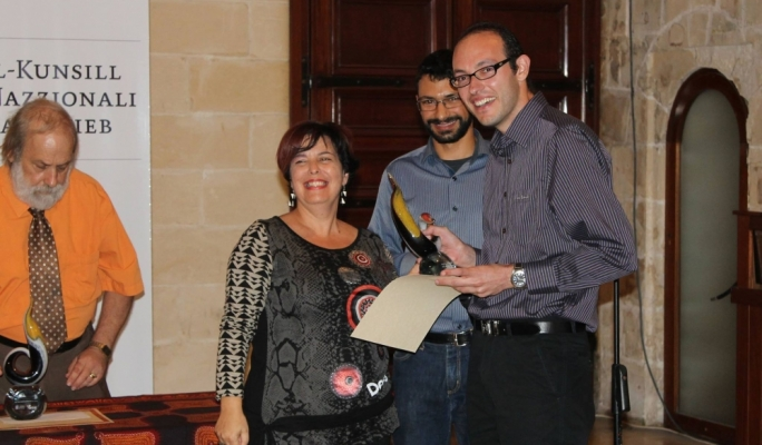 Stephen Lughermo receiving the Novels for Youth prize for his novel 'X'aħna Smart'