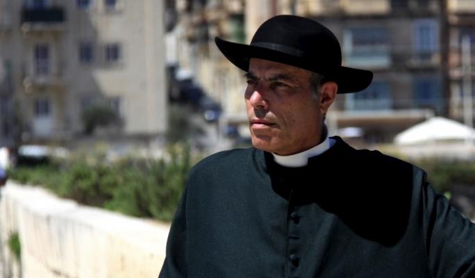 Pino Scicluna as Dun Salv, 'The Kappillan of Malta'