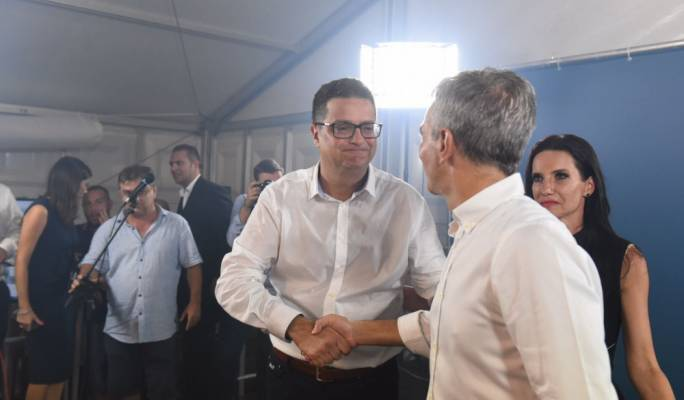 Simon Busuttil (right) congratulated Delia on his victory