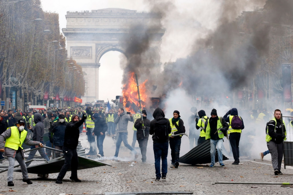 Macron tells PM to hold talks after worst riots in Paris in years