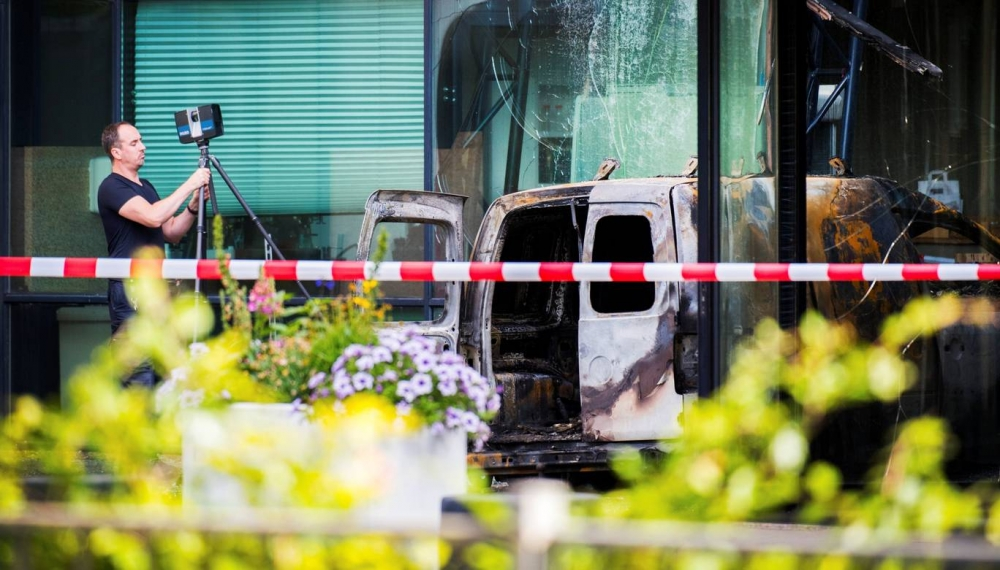 Van crashes into leading Dutch newspaper's office