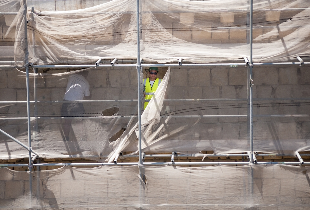 How many foreign workers in Malta?