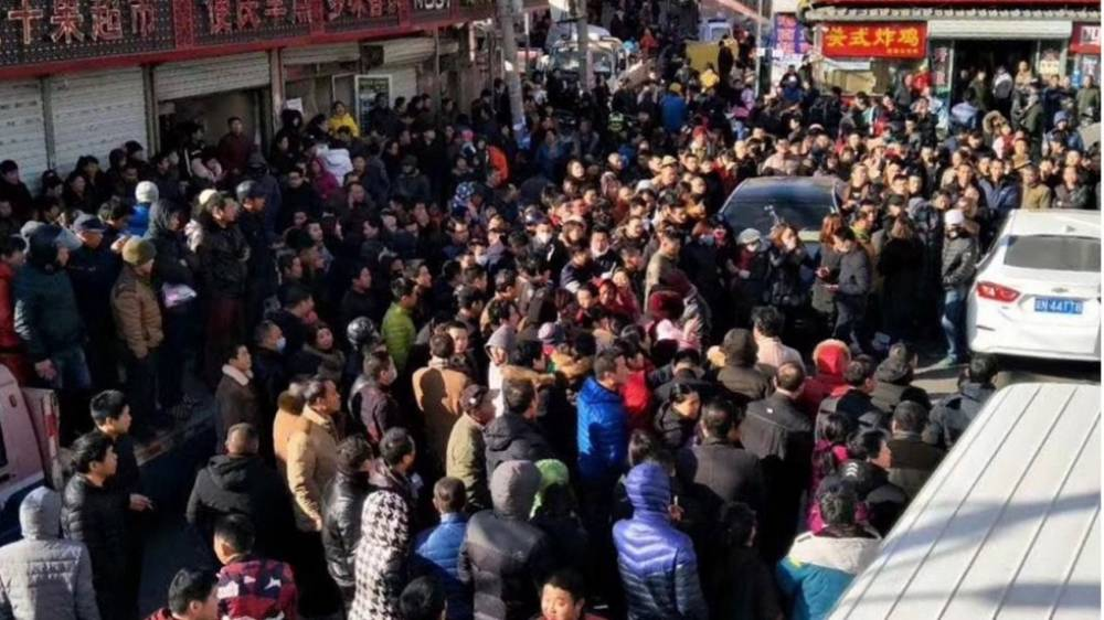 [WATCH] Beijing: hundreds protest over migrant crackdown