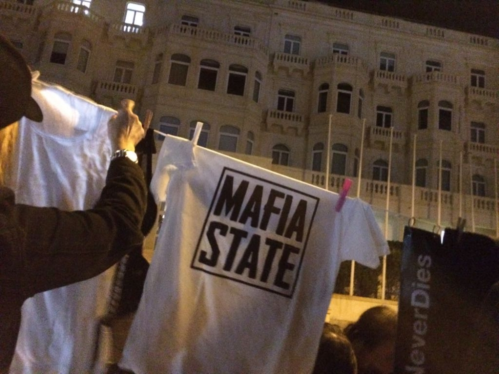 Occupy Justice activists peg 'mafia state' laundry outside shuttered Pilatus bank