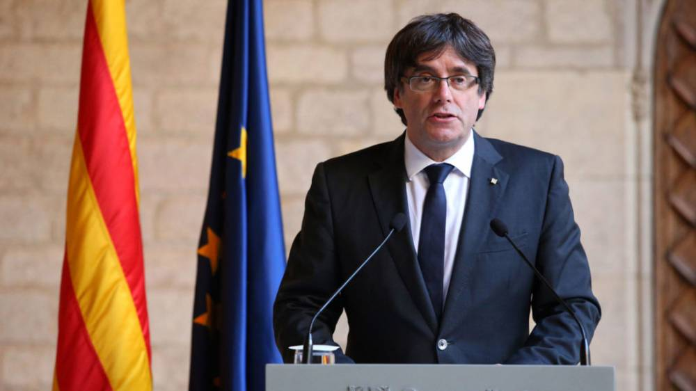 Spain renews arrest bid as ex-Catalan leader arrives in Denmark